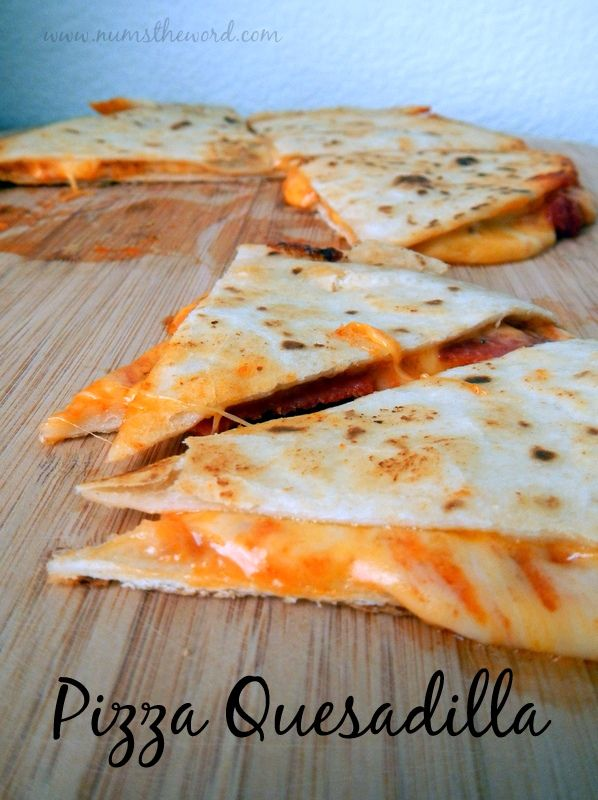 Num's the Word:  These easy Pizza Quesadillas are ready in 10 minutes and make the perfect lunch or dinner that the kids (and grown-ups) will love!  Easy, Simple, Tasty.