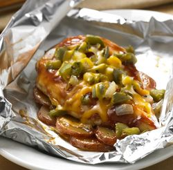 Barbecue Chicken Dinner Packets ... Chicken breasts on top of sliced potatoes, flavored with barbecue sauce, bell peppers and cheese create easy individual dinner packets that are great for cooking on the grill.