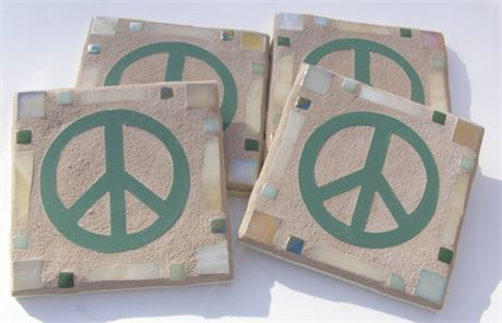 This set of 4 Sage Green Coasters feature a Green Peace Sign Center with 2 Soft Green and 2 Yellow Ochre Glass outside corner tiles. There are alternating Light Green and Sage Green colored small glass tiles above and below the Creamy Yellow Tumbled Glass border on each side of the coasters.  The back of the coaster is a Bisque (Off White) ceramic tile. The grout is Haystack (Tan). The coasters measure 4.25 x 4.25 inches.  This is my own original design so these are truly unique! Great gift…