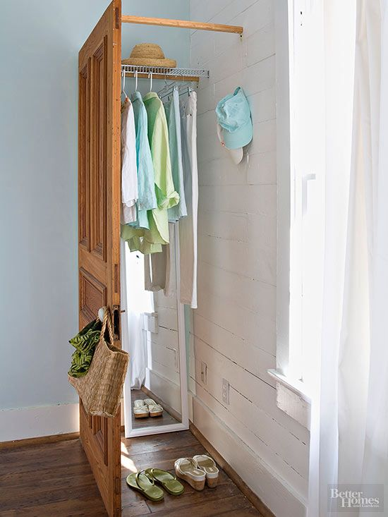 "When closet space is a must-have, yet nowhere in sight, this easy alternative will give you the storage you need. Mount a freestanding door to the walls in a corner and brace it with wood strips. Use racks and hooks to outfit your new ""closet"" with functional organizers."