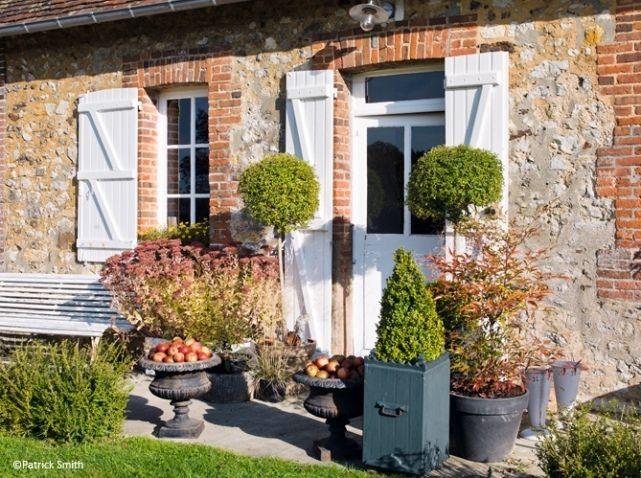 Entree maison pots de fleurs
