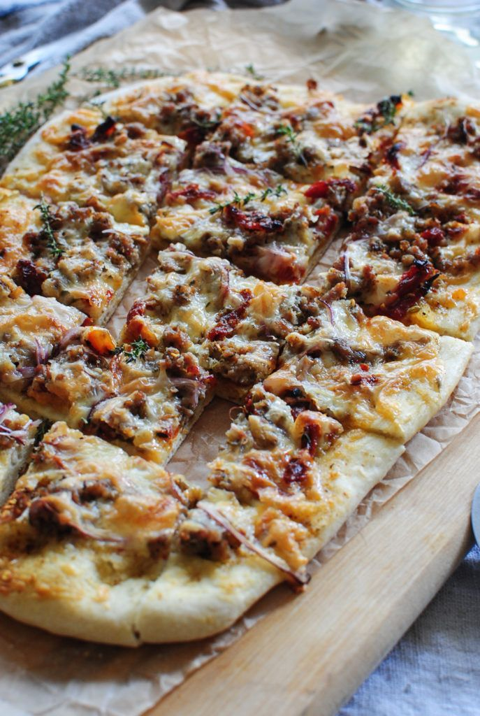 Sun Dried Tomato Pizza with Sausage and Roasted Garlic