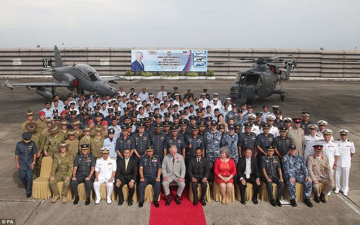 The Prince of Wales sits for a group photo with members of the Royal Malaysian Air Force a...