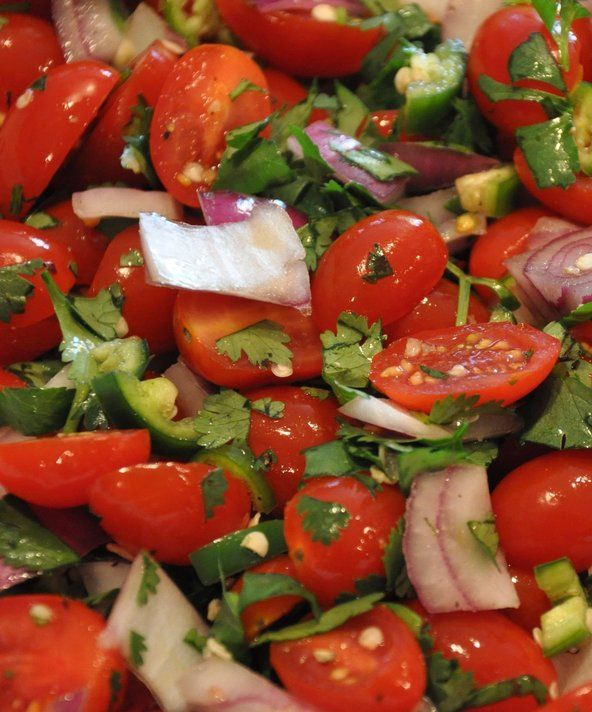 Recipe for Fresh and Spicy Grape Tomato Salad - Sometimes it's the simple dishes that pack the most flavor. This recipe is fast, easy and full of freshness. Enjoy