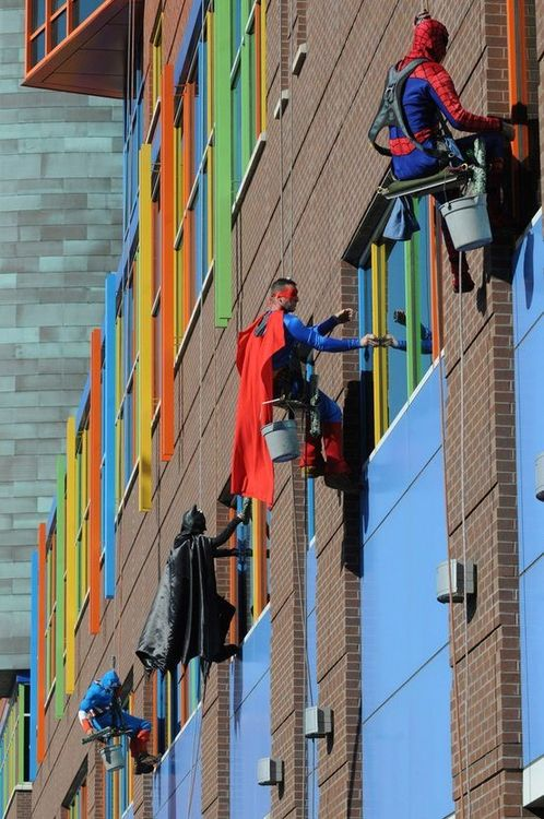 These men are window washers at a children's hospital in Pittsburgh. Some might think the job is menial, but to the kids who are horribly ill, looking out their window seeing their favorite superhero at their window makes all the pain go away for a bit. And that would make the job worthwhile.