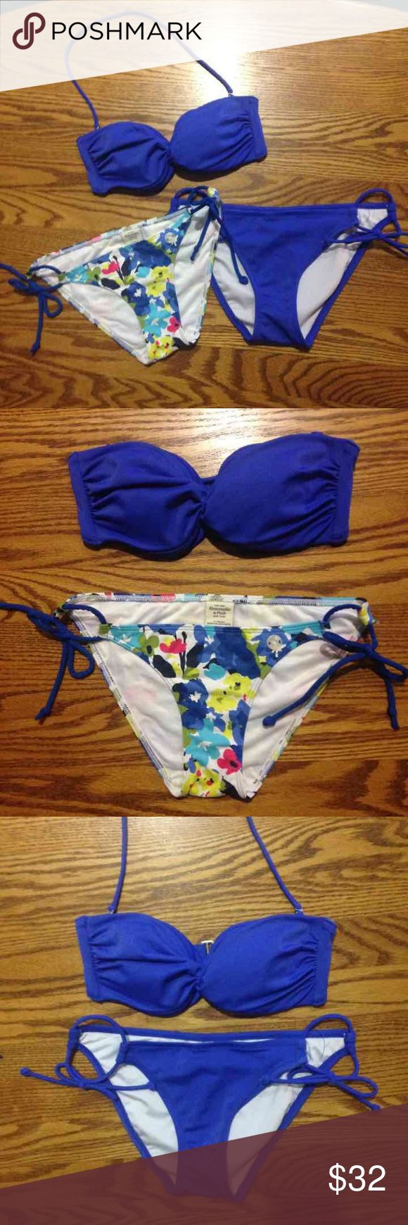 Victoria's Secret + A&F XS bikini set All pieces XS Solid pieces from Victoria's Secret NWOT Abercrombie & Fitch floral bottoms worn once Top can be worn strapless or halter (vs multiway) Victoria's Secret Swim Bikinis