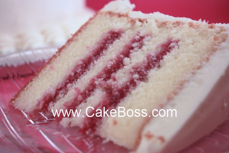 Cake Boss Cake Recipe  1 box Pillsbury or Betty Crocker White or Vanilla cake mix    1 cup granulated sugar  1 cup + 2 tbsp cake flour (NOT all-purpose flour)  1/8 tsp salt  1 1/3 cups water  3 eggs  1/2 cup melted butter (lightly salted)  1 cup sour cream  1 tsp vanilla extract or almond extract (optional