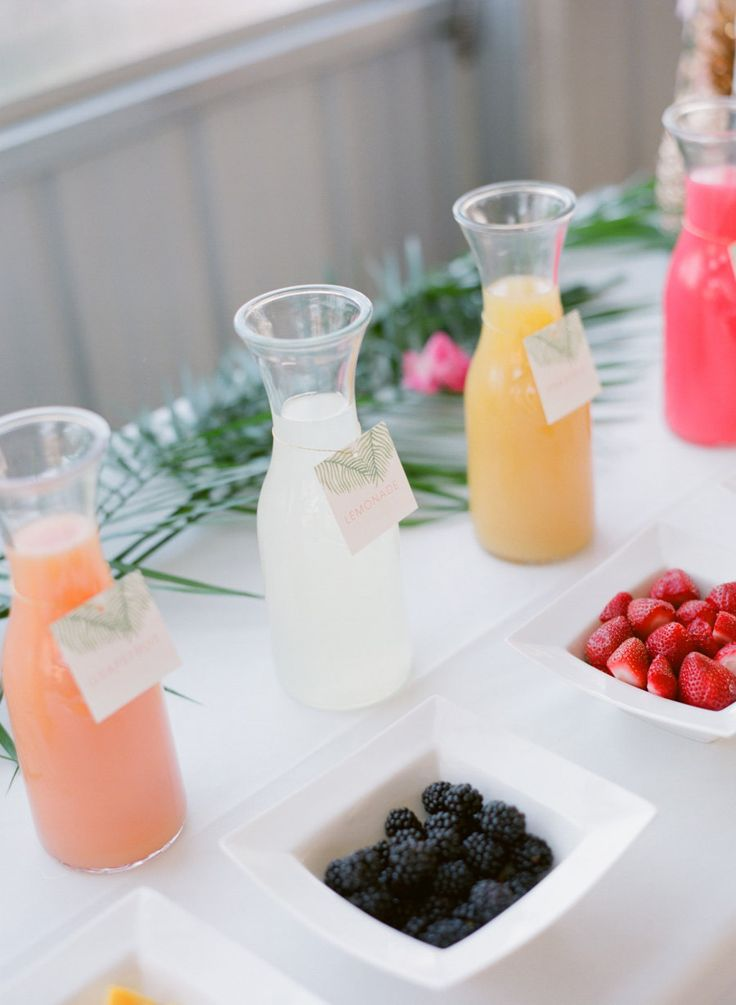 A mimosa bar with all the right fixings: http://www.stylemepretty.com/2016/06/15/inspiration-for-a-flirty-tropical-bridal-shower/ | Photography: Jody Savage - http://www.jodysavagephotography.com/