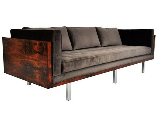 Dramatic! The couch is sitting in the beautiful wood frame (full on back) -- from 10 Dark & Moody Hued Sofas - at apartmenttherapy.com (modern furniture, living room)