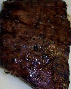 Make sure to serve a steak that sizzles at your summer cookouts by grilling this flat iron steak recipe from Food.com.