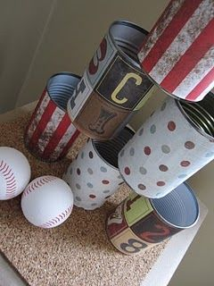 decorate some cans with scrap booking paper for a fun, easy and inexpensive outdoor party game for kids