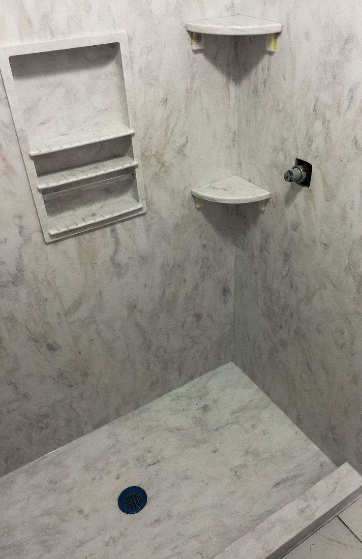 This Solid Surface Shower In The Corian Color Rain Cloud Was Installed In A Local Csra Home With A No Shower Remodel Master Bathroom Shower Corian Shower Walls