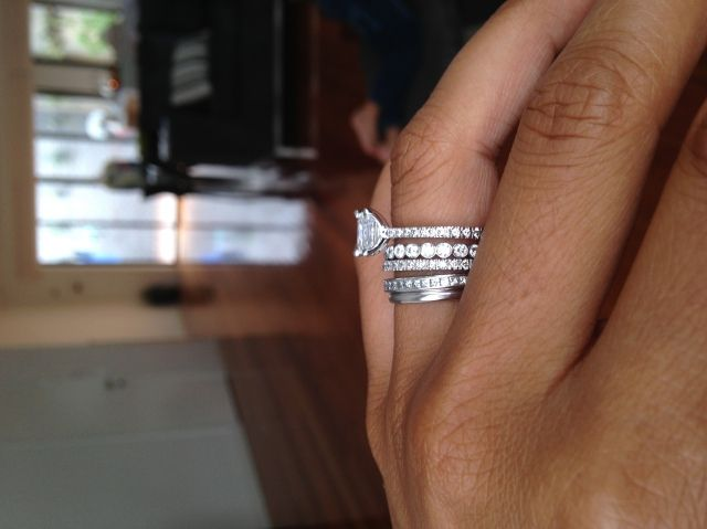 engagement ring, wedding band, & a band for each child. Love the idea
