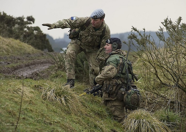 Picture shows a member of Falklands Company Directing Staff (DS) instructing an officer cadet taking part in Exercise Dynamic Victory, Dalbeattie Training Area, Scotland.