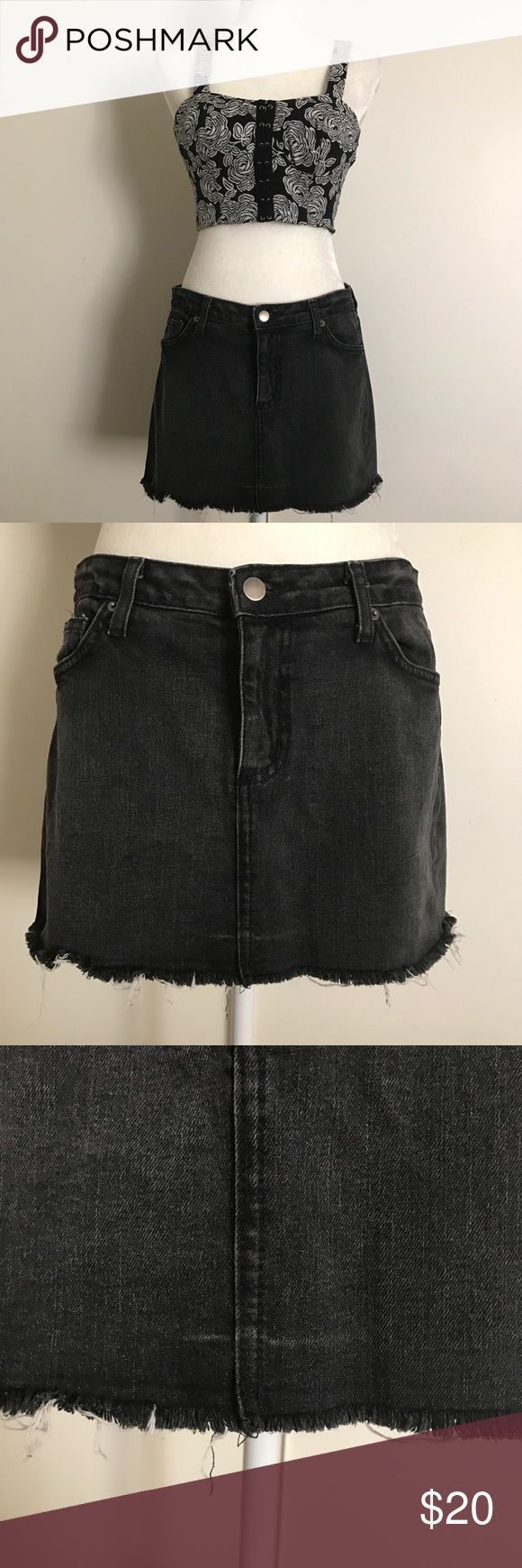 "🔥 Urban Outfitters Black Denim Mini Skirt This mini skirt is about 12.5"" long - please keep in mind this fits very short on curvier girls!   The skirt is stretchy and very comfortable!   Has a some discoloration as show in the photo, but it adds to the distressed look.  Material: 99% Cotton, 1% Spandex Machine Wash Cold Lux Skirts Mini"