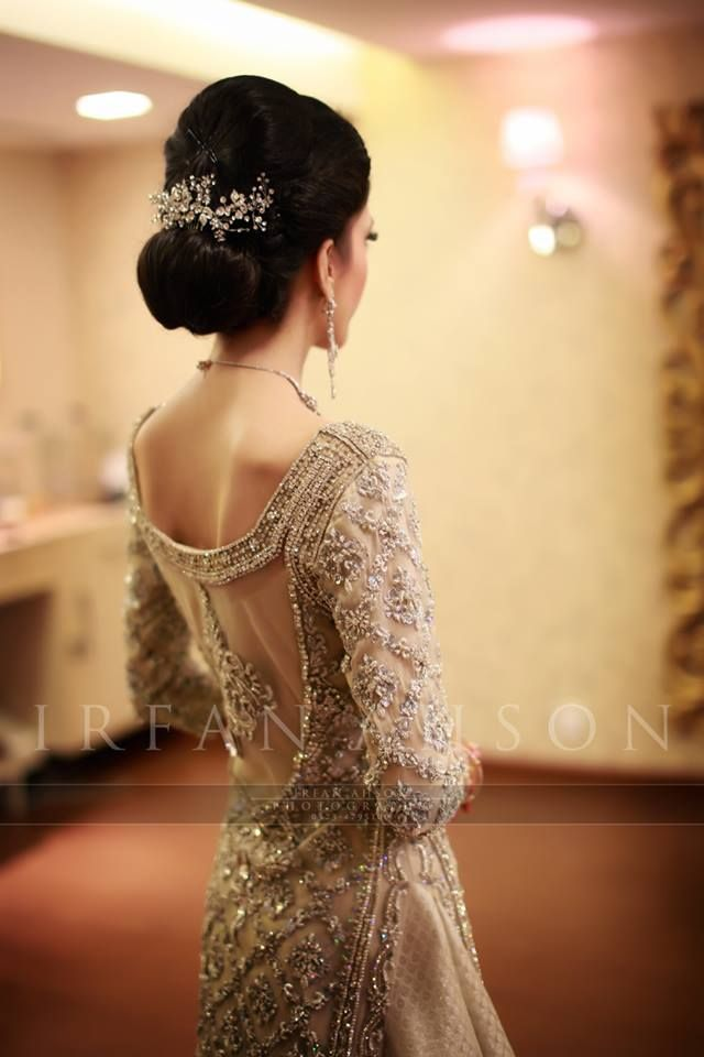 Beautifully crafted backless white bridal lengha captured by the one and only Irfan Ahson.