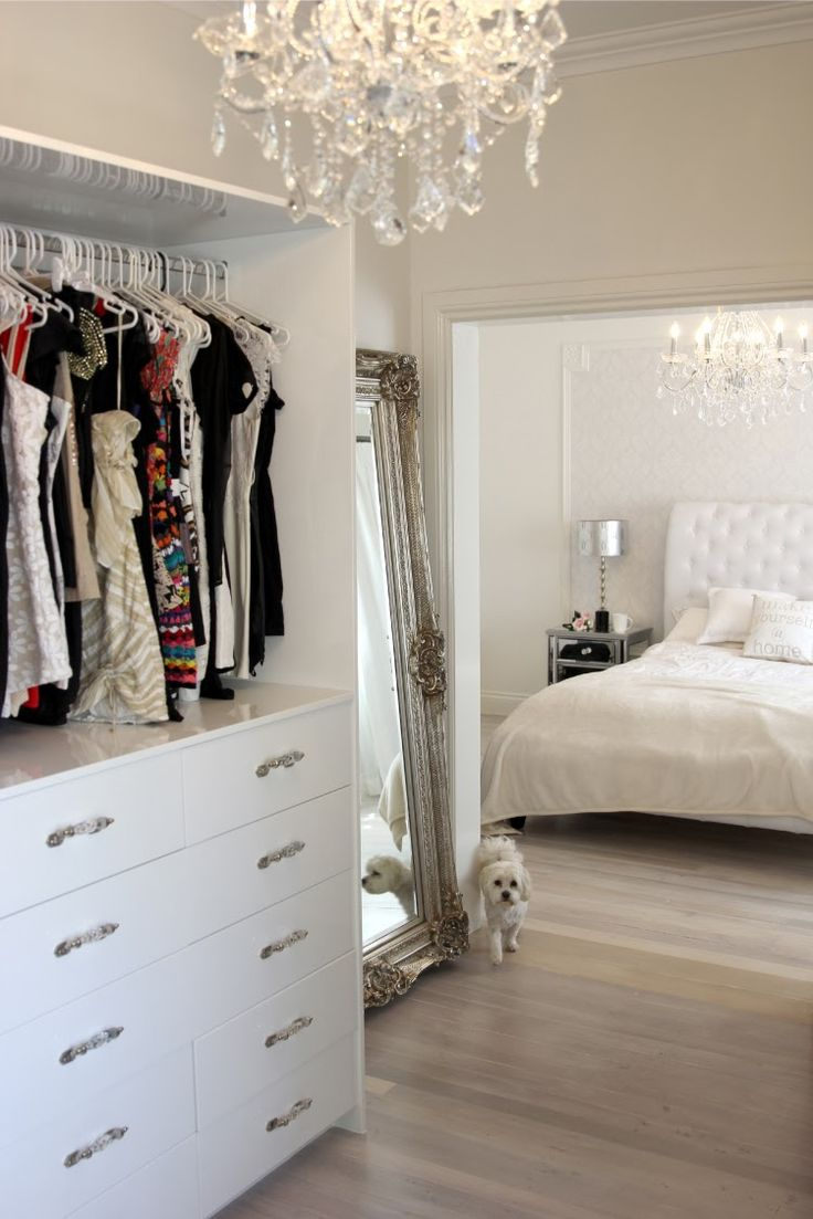 All white, silver baroque mirror and crystal chandlier. Perfect glam.