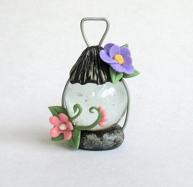 Miniature Fairy Lantern - a marble, some fimo and some wire. sweet.