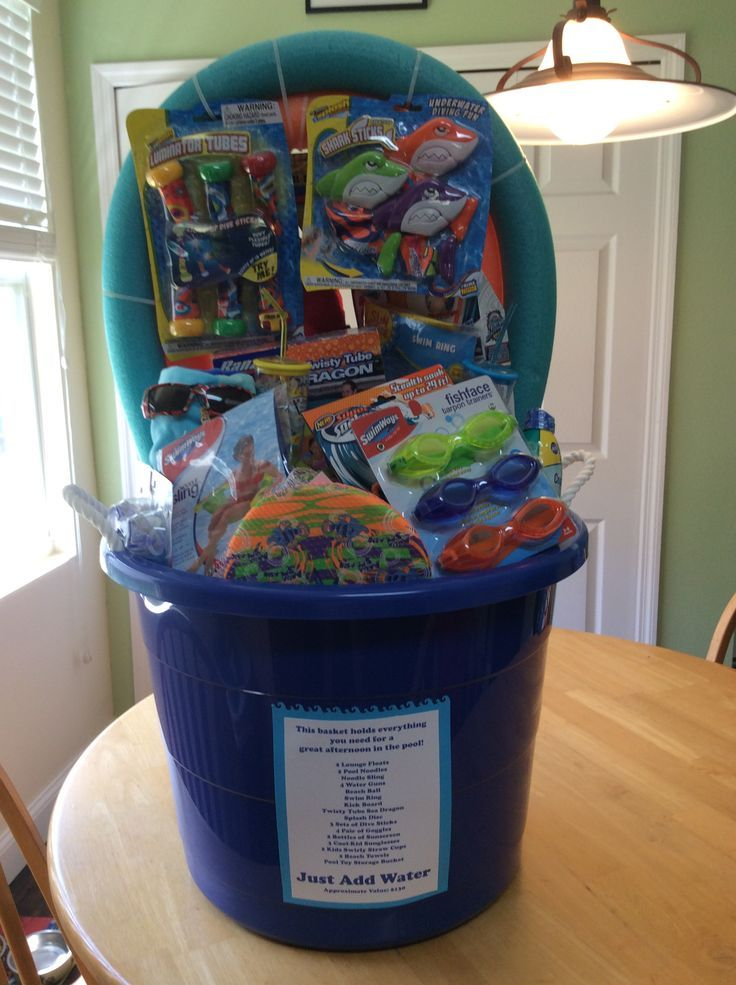 """Just Add Water"" pool party silent auction basket. Towels, sunscreen, goggles & pool toys galore!"