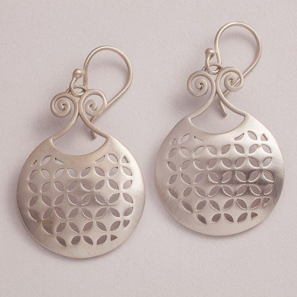 Classic silver earrings handcrafted and finished for a matt satin feel. Designed by Puja Bhargava Kamath of Lai, they form part of the Malakeh collection, inspired by Islamic Central Asia. Sterling silver with gold-plating and semi-precious stones.