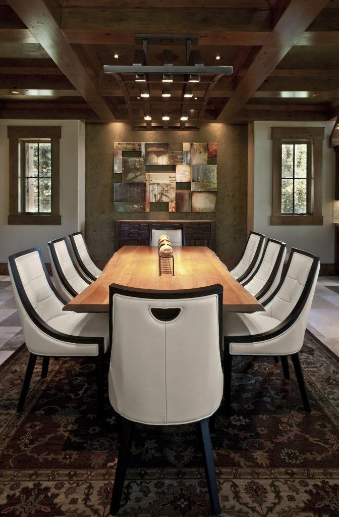 These black and white dining chairs have deep seats for the ultimate in comfort. The more contemporary dining set is contrasted with the more traditionally patterned rug.