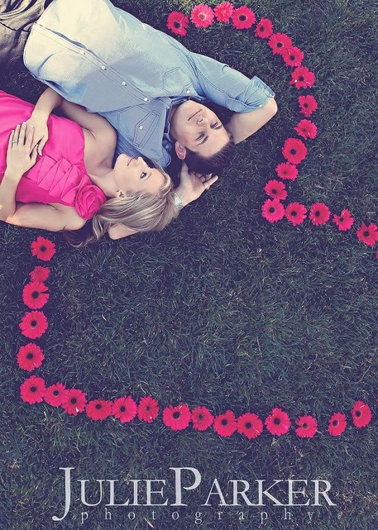 Cute couple photo idea w heart shaped by flowers.