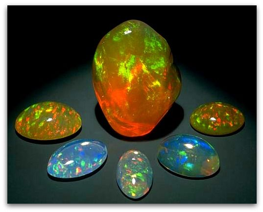 "Birthstone of October: Opal. The name opal derives from the Greek Opallos, meaning ""to see a change (of color)."" Opal has been associated with hope, faith, and confidence.  Opals range in color from milky white to black with flashes of yellow, orange, green, red, and blue. An opal's beauty is the product of contrast between its color play and its background."