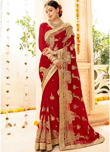486dcf5492 Enchanting red #bridal #saree in #georgette enhanced by heavy zari  embroidery, stone work and golden lace border throughout.