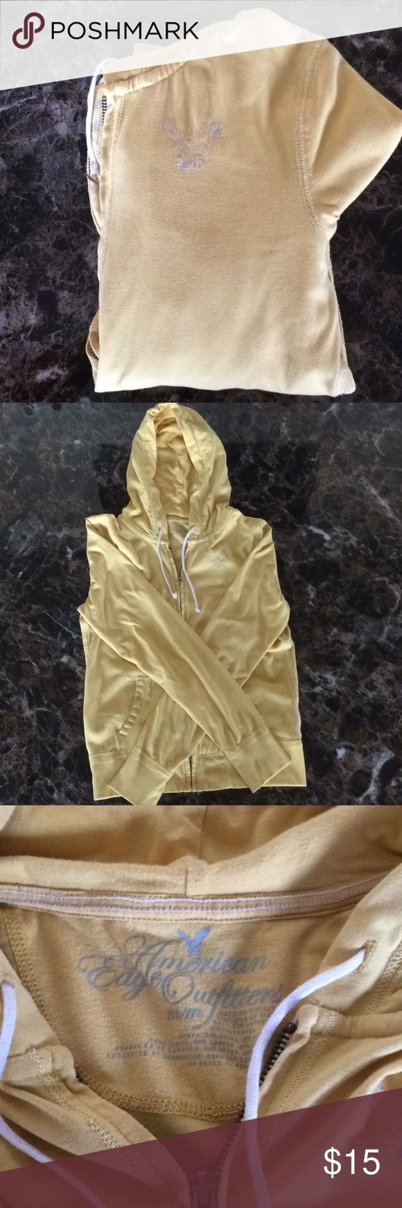 American Eagle Outfitters zip up hoodie 🦅 American Eagle Outfitters zip up hoodie. Great condition, rarely wore. Sad they don't fit me anymore. Very comfortable zip up hoodie.  Color is a beautiful yellow. Not dark and not light, 2nd picture captured the color better. American Eagle Outfitters Tops Sweatshirts & Hoodies