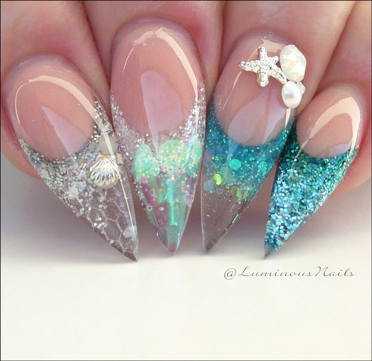 Ocean nails with a bit of glitter and some sea shells perfect foe the summer