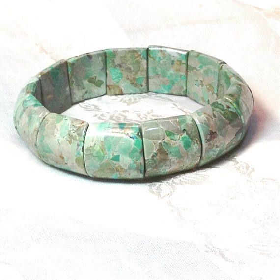 Handmade stretch cuff bracelet in green imperial jasper, so on trend this year! About imperial jasper, also known as sea sediment jasper: This jasper is said to be gently stimulating and extremely protective. It neutralizes radiation and other forms of environmental and