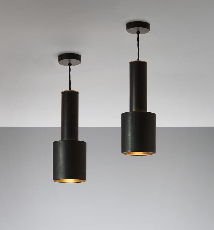 ALVAR AALTO Pair of 'Hand Grenade' ceiling lights, model no. A111, circa 1962 Brass, painted metal. Each: 33.5 cm (13 1/4 in.) high, 12.3 cm (4 7/8 in.) diameter, variable drop Manufactured by Valaistustyö Ky, Finland