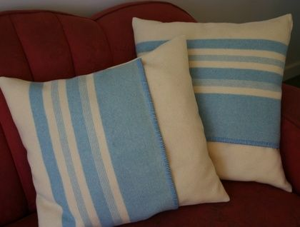 Old wool blankets upcycled into funky cushion covers
