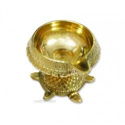 Vedicvaani.com|Buy Kuber Kurma Vastu Diya Oil Lamp Online, USA/Canada/UK/Europe at best price, Free worldwide shipping, This is a very unusual Diya as it has been placed upon a kurma or tortoise pedestal.The tortoise is the symbol of the prana, cosmic breath, which is the support of the universe.The kurma or tortoise breathes in, and moves freely between, the spheres of earth (financial aspects) and water (emotions) representing their harmonious integration, upon which the Kubera lamp…