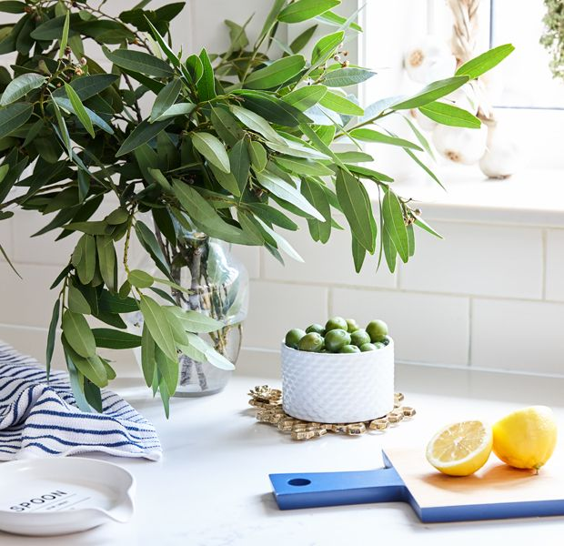 Countertop Accessories | Keep your counters clean with practical and stylish accessories like a contemporary spoon rest, trendy golden pineapple-shaped trivet and serving boards. | #walmart #hometrends #sponsored