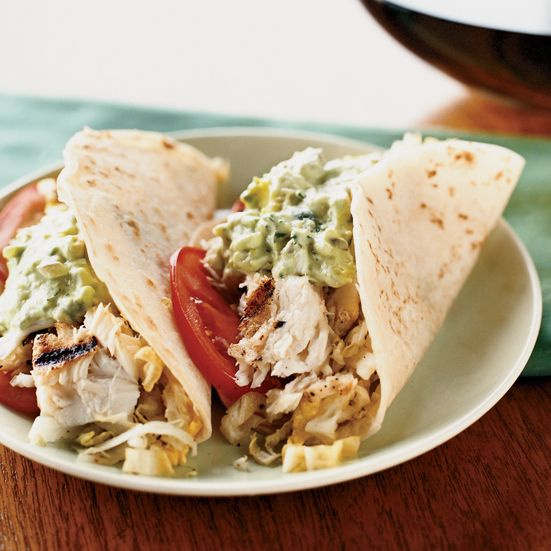 Fish Tacos with Creamy Lime Guacamole and Cabbage Slaw   This is the ultimate recipe for grilled fish tacos. Fish tacos are a staple among California surfers but are often beer-battered and fried. For this healthier, grilled version of fish tacos, chef Kerry Simon enriches the guacamole with low-fat sour cream and adds lots of flavor with sliced jalapenos, red onion and cilantro. The crispy, tangy slaw is made by simply tossing cabbage with an instant lime vinaigrette.