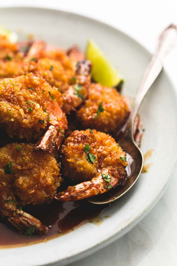 Sweet and tangy baked crispy honey lime shrimp is lighter than fried versions with the most incredible sticky honey, lime, and garlic glaze.