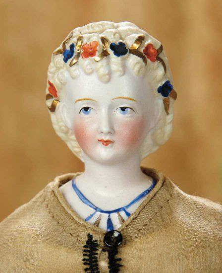 "13""-German Bisque Lady Doll, Hair Ornaments and Necklace, Attributed to Conta and Bohne~~~blonde sculpted hair with ringlet curls that tumble onto her forehead, the hair decorated with vibrant blue and red flowers and gold leaves, elaborate ringlet curls,painted blue necklace with blue and gold beading, muslin stitch-jointed body, bisque lower arms, lovely antique costume. Condition: generally excellent. Comments: Germany, circa 1870, attributed to Conta and Bohne."