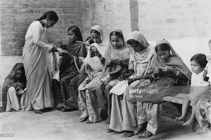 A knitting lesson in progress for young women in an Indian Army Child Welfare Centre