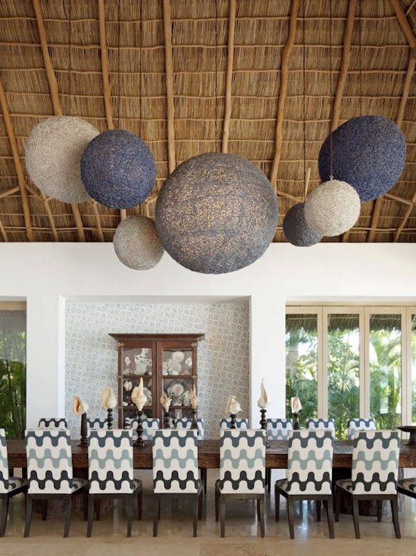 """Rattan ceiling and """"string"""" pendant lighting in various sizes make a big impact on a dining room with high ceilings"""