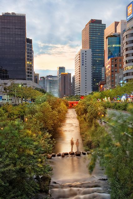 "'Cheonggyechong Stream at Sunset,' Ihwa-dong neighborhood, Jongno-gu, Seoul, South Korea | Flickr. Photographer wrote: ""A canal that flows across Seoul's downtown. This area was renovated a few years ago and has now become one of the top places to visit, especially in the evening."""