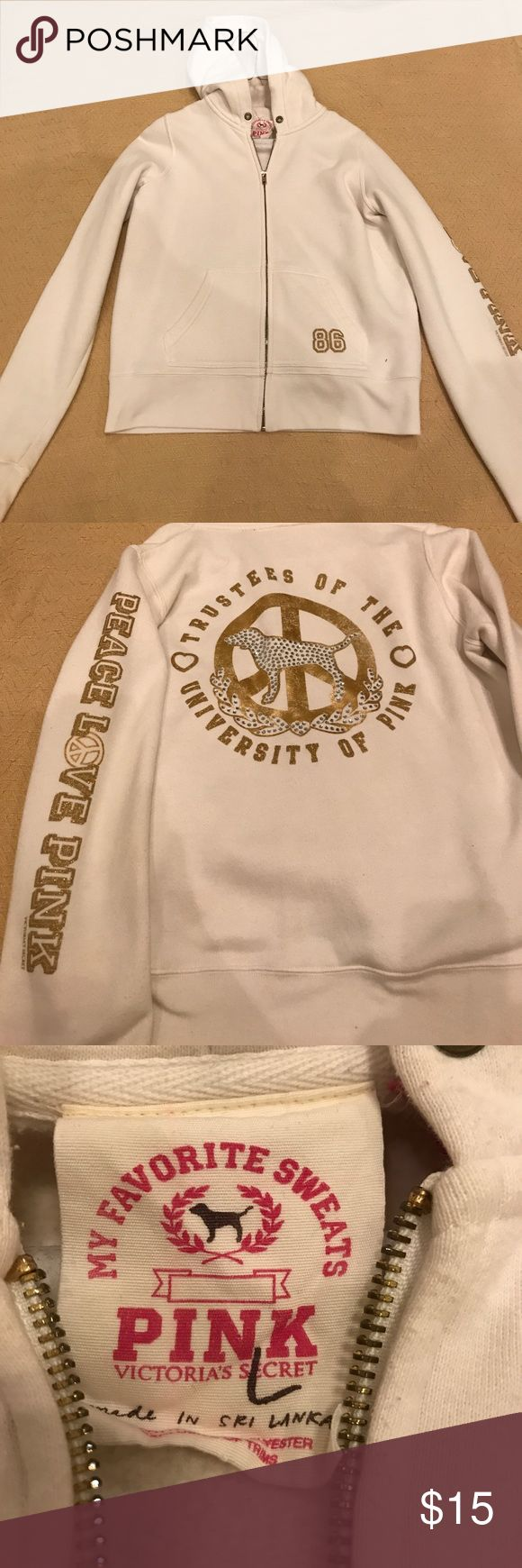 Victoria's Secret PINK Zip Up Hoodie This is an off white Victoria's Secret PINK Zip Up Hoodie. The writing and pictures on the hoodie are gold. There are also rhinestones on the jacket. This hoodie has been worn. PINK Victoria's Secret Jackets & Coats