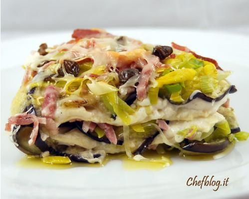 Lasagne al forno con melanzane, porri e prosciutto cotto