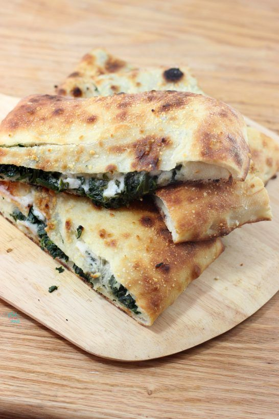 Spinach Garlic Stuffed Pizza (vegan, dairy free) via A Whisk and Two Wands