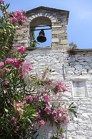Church with steeple and flowers in the Greece