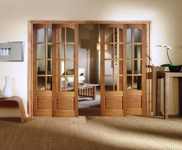 Beautiful Interior Wooden Sliding French Doors as Room Dividers. could work in basement between office & tv area.