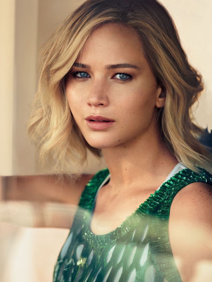 Jennifer Lawrence stars as a cover girl for the December 2015 issue of Vogue magazine, photographed by Mikael Jansson