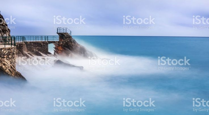 stormy sea over romantic seafront at blue hour foto stock royalty-free