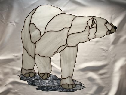 Almost monochrome stained glass of Polar Bear.  White glass is textured.