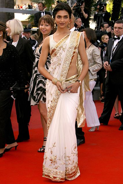 30 Gorgeous Sari Outfits— Traditional, Modern, & Unexpected  #refinery29  http://www.refinery29.com/sari-outfits#slide9  Deepika Padukone in white and gold.